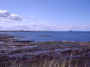View towards Belhaven Bay (John Muir Country Park) from Dunbar with North Berwick Law and Bass Rock in the distance.