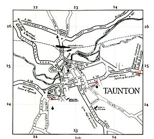 An old map showing the main roads and the river in the town.