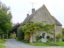 Cotswold house with Wisteria - geograph.org.uk - 1514014.jpg