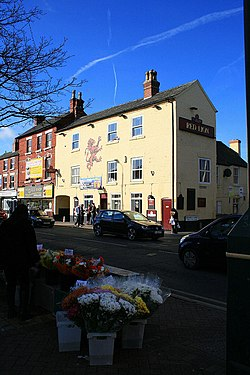 The Red Lion and flower seller - geograph.org.uk - 1752493.jpg